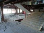 Вскрытие верхнего слоя стяжки перекрытия, для последующего распила перекрытия второго этажа.